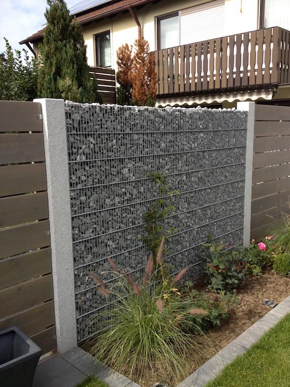 Gabionenwand als Stützmauer für den Garten am Hang